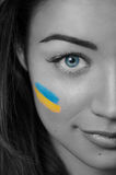 Girl with Ukrainian flag on her cheek. Black and White. Partly color Royalty Free Stock Photos