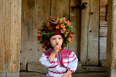 Girl in the Ukrainian national clothes with folk toys Royalty Free Stock Photos