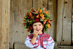 Girl in the Ukrainian national clothes with folk toys Stock Photo