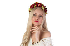 Girl in Ukrainian national costume and flower chaplet Stock Photo
