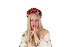 Girl in Ukrainian national costume with her finger in Stock Photo