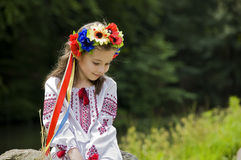 Girl in ukrainian national costume. Posing outdoors Royalty Free Stock Photography