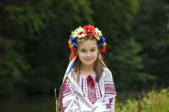Girl in ukrainian national costume. Posing outdoors Stock Photos