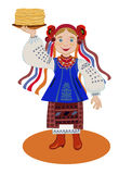 The girl in the Ukrainian national costume regales pancakes on S Royalty Free Stock Photos
