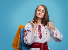 Girl in the Ukrainian national dress and shopping bags Royalty Free Stock Photo