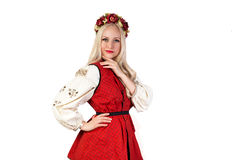 Girl in Ukrainian national traditional costume and chaplet Royalty Free Stock Image