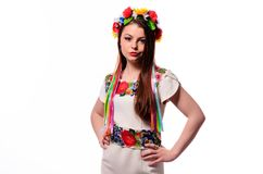 Girl in Ukrainian national traditional costume holding her flowe. R chaplet stock photos