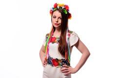 Girl in Ukrainian national traditional costume holding her flower chaplet - isolated on white Stock Image