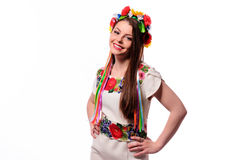 Girl in Ukrainian national traditional costume holding her flower chaplet - isolated on white Royalty Free Stock Image