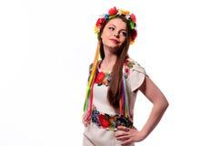Girl in Ukrainian national traditional costume holding her flower chaplet - isolated on white Stock Photo