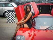 girl on ultima GTR Stock Photography