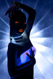 Girl with ultraviolet make-up disco dance Stock Images