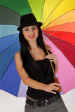 Girl with umbrela. Brunet girl with a colorful umbrella Stock Photo