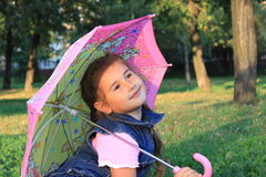 Girl with umbrella. The girl in the park playing with the umbrella Royalty Free Stock Photo