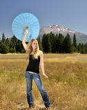 Girl with umbrella. Teen girl holding umbrella above head Stock Images