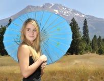 Girl with umbrella. Beautiful blonde teen with umbrella Stock Photos