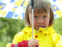 Girl with umbrella. Little girl with umbrella and rain coate Stock Photography