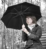 Girl with an umbrella Stock Image