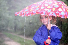 Girl with umbrella. Young girl with an umbrella on a rainy day Royalty Free Stock Images