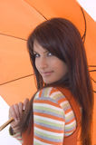 Girl and umbrella. Pretty girl with orange umbrella in her hand Royalty Free Stock Image