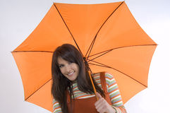 Girl and umbrella. Pretty girl with orange umbrella in her hand Stock Image