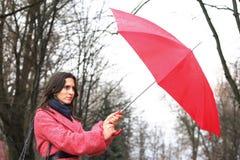 The girl with a umbrella Stock Photos