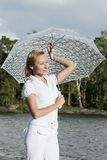 Girl With Umbrella. Beautiful girl stayng and relaxing near the sea stock image