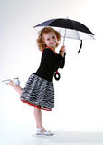 Girl with umbrella. Pretty little girl standing under black umbrella Royalty Free Stock Photo