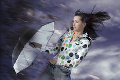 Girl with umbrella. Beautiful girl with umbrella in rainy storm clouds. Rainy weather Royalty Free Stock Photos