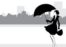 Girl with umbrella. Against the background of the city Stock Photos