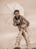 Girl and umbrella Stock Images