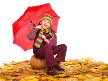 Girl with umbrella on autumn leaves on white Royalty Free Stock Photos