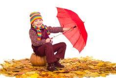 Girl with umbrella on autumn leaves on white Stock Photos