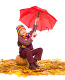 Girl with umbrella on autumn leaves on white Royalty Free Stock Images