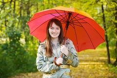 Girl with umbrella in autumn park Royalty Free Stock Images