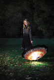 Girl with umbrella in autumn park. At evening Stock Images