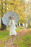 The girl with an umbrella in autumn park Royalty Free Stock Images