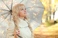 The girl with an umbrella in autumn park Stock Photography