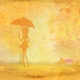 Girl with umbrella. In autumn scenery Stock Photos
