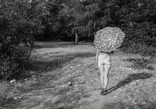 Girl with umbrella, b&w photo Stock Image