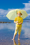 Girl with umbrella on a beach Royalty Free Stock Photo