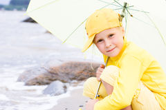 Girl with umbrella on a beach Royalty Free Stock Image