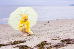 Girl with umbrella on a beach Stock Photography
