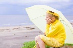 Girl with umbrella on a beach Stock Photo