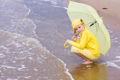 Girl with umbrella on a beach Royalty Free Stock Photos