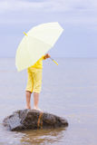 Girl with umbrella on a beach Stock Photo