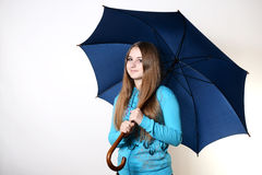 Girl with an umbrella. Girl with blue umbrella on a white background Stock Photos