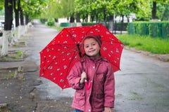 Girl with an umbrella Stock Image