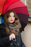 Girl with umbrella. Girl with color palette umbrella Royalty Free Stock Photos