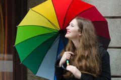 Girl with umbrella. Girl with color palette umbrella Royalty Free Stock Image